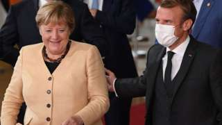 German Chancellor Angela Merkel with French President Emmanuel Macron at EU summit in Brussels, 21 Oct 21