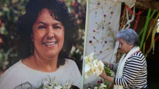 The president of the NGO Committee of Relatives of the Disappeared in Honduras (COFADEH), Bertha Oliva, lays a wreath on an alter in memory of murdered indigenous Honduran environmentalist Berta Caceres, in La Esperanza,