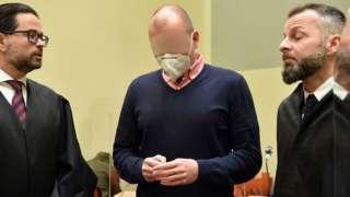 Sports doctor Mark Schmidt (c) in court in Munich during his trial. 15 Jan 2021