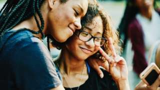 Two teens taking a selfie