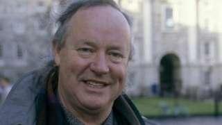 Brendan Kennelly outside Trinity College Dublin
