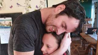 Stephen hugging his daughter