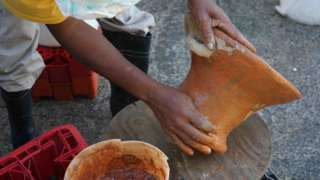 A traditional coal pot being made by hand