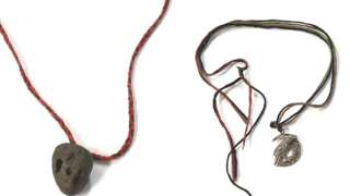 Two necklaces worn by the woman police are trying to identify