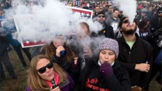 Demonstrators vape during a consumer advocate groups and vape storeowners rally outside of the White House to protest the proposed vaping flavor ban in Washington DC on 9 November 2019.