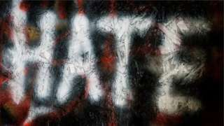 'Hate' spray-painted sign