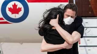 Former diplomat Michael Kovrig embraces his wife Vina Nadjibulla following his arrival in Toronto