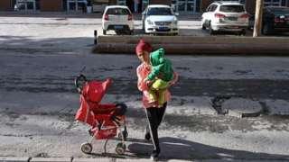 A woman and a child in Aksu, Xinjiang