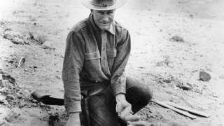 Roy Chapman Andrews Holds Dinosaur Eggs