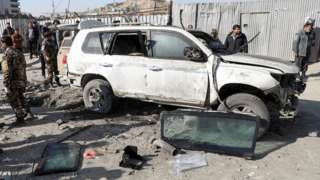 Afghan security officials inspect the site of a bomb blast in Kabul, Afghanistan December 15, 2020
