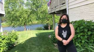 Cristina Pasa Gibson, shown at her parents' house in Gainesville, Virginia, standing outside