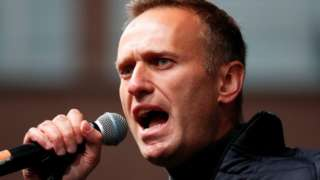 Russian opposition leader Alexei Navalny delivers a speech during a rally to demand the release of jailed protesters