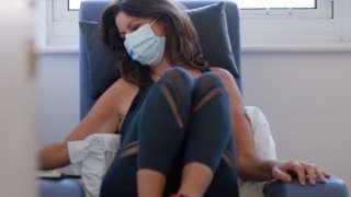 woman wearing mask having chemotherapy