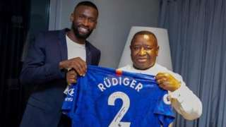 Chelsea's Antonio Rudiger (left) hands over a signed shirt to Sierra Leone President Julius Maada Bio