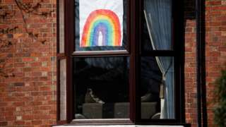 A hand-drawn picture of a rainbow is seen in a window in Liverpool, as the spread of coronavirus disease (COVID-19) continues. Liverpool, Britain