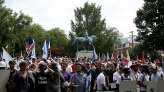 Far-right protesters converge around the statue of a Southern general
