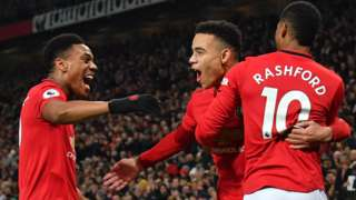 Manchester United's players celebrate scoring against Newcastle United