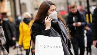 Woman carrying Topshop bag