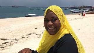 Khadija Abdulla Ali sitting on beach