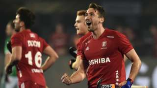 England hockey player David Condon celebrates after scoring his side's opening goal in a 4-2 win over Ireland at the World Cup