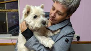 Razzi, the West Highland Terrier with owner