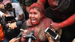 Patricia Arce speaks to the media after being attackedby a crowd that sprayed her with reddish paint and cut her hair in Vinto, Bolivia, 06 November 2019
