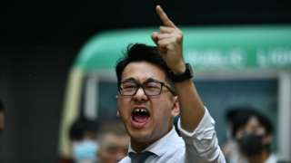 A man yells at police during a protest in Hong Kong's Central district on November 11, 2019.