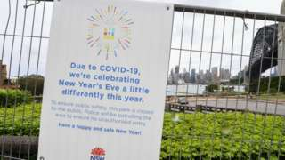 Warning signs are displayed on security fencing in the suburb of Kirribilli ahead of this year's firework display on December 30, 2020 in Sydney
