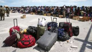 Hurricane Dorian survivors wait to evacuated in private boats at the Marsh Harbor Port on Grand Abaco Island
