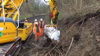 Network Rail staff working to clear the track