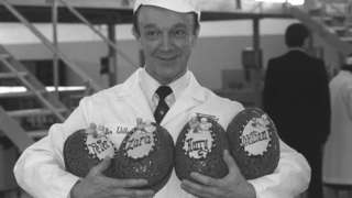 Walter Willen holds Easter eggs decorated for the Queen's grandchildren