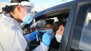 Frontline healthcare worker Joanne Grajeda administers a nasal swab test at a drive-in COVID-19 testing site amid a surge of COVID-19 cases in El Paso on November 13, 2020 in El Paso, Texas.