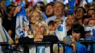 Suporters of National Party presidential candidate Luis Lacalle Pou wait for the results after the second-round presidential election, in Montevideo, Uruguay November 24, 2019.
