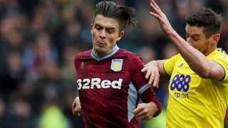 Jack Grealish of Aston Villa is caught by Lukas Jutkiewicz of Birmingham City