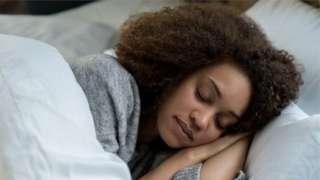 Woman dey sleep