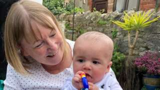 Grandmother Ann Phillips with grandson Theo