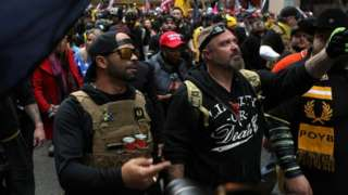 Proud Boys march in protest in December in Washington DC