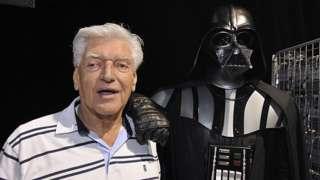 David Prowse stood next to Darth Vader