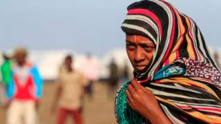 An Ethiopian refugee, who fled the Tigray conflict, walks in the Tenedba camp in Mafaza, eastern Sudan - January 2021