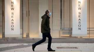Man in mask walking in Cardiff