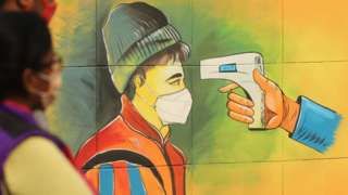 A mural in Delhi showing temperature testing