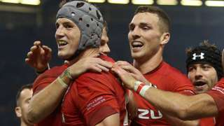 Wales' Jonathan Davies, George North and Leigh Halfpenny celebrate