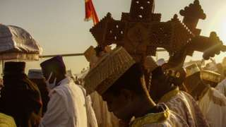 Members of Ethiopian orthodox church is seen holding Holy crosses for the high priest during the celebration of Ethiopian Epiphany in Addis Ababa Ethiopia January 18 2020.