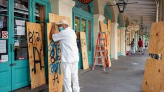 City of New Orleans worker Louis Marrero boards up businesses in the French Quarter as the city braces for the arrival of Tropical Storm Sally in New Orleans, Louisiana, U.S., September 14, 2020