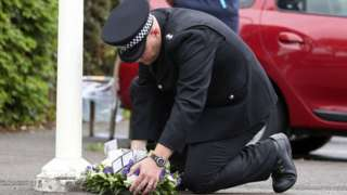 Officer laying wreath