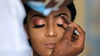 A Kenyan bride (C) has her make-up done as she prepares for her wedding ceremony in Kiambu, Kenya, 14 November 2020 (issued 15 November 2020). Kenyan President Kenyatta announced on 04 November 2020 the extension of a nationwide COVID-19 night curfew from 10pm to 4am until 03 January 2021 and the ban of political rallies for 60 days as coronavirus infections surged.