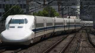 JR Tokai's Tokaido Shinkansen bullet trains stand at platforms at Tokyo station in Tokyo, Japan, 18 May 2015.