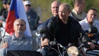 Russian President Vladimir Putin rides a bike in Sevastopol, Crimea on 10 August 2019