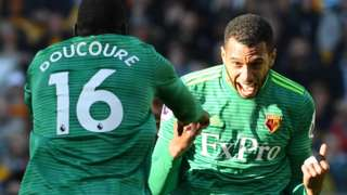 Etienne Capoue celebrates his goal with Abdoulaye Doucoure