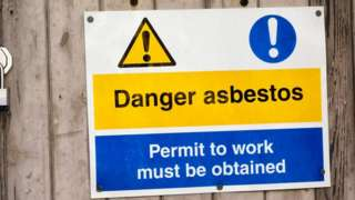 A sign warning of asbestos danger